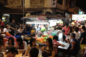 Chulia Street hawkers draw a crowd in George Town.